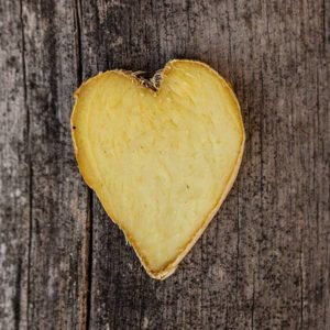 heart-shaped piece of ginger on wood