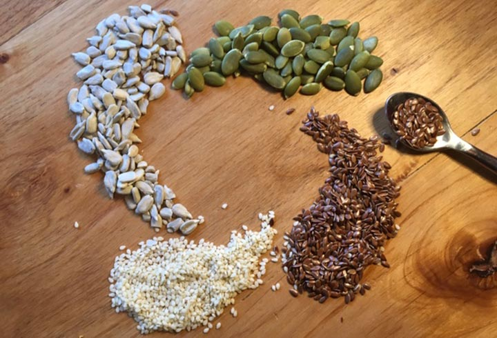 Pumpkin, sunflower, flax, sesame seeds in yin/yang circle